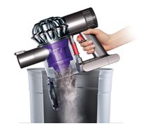 Dyson DC58 being emptied into the bin